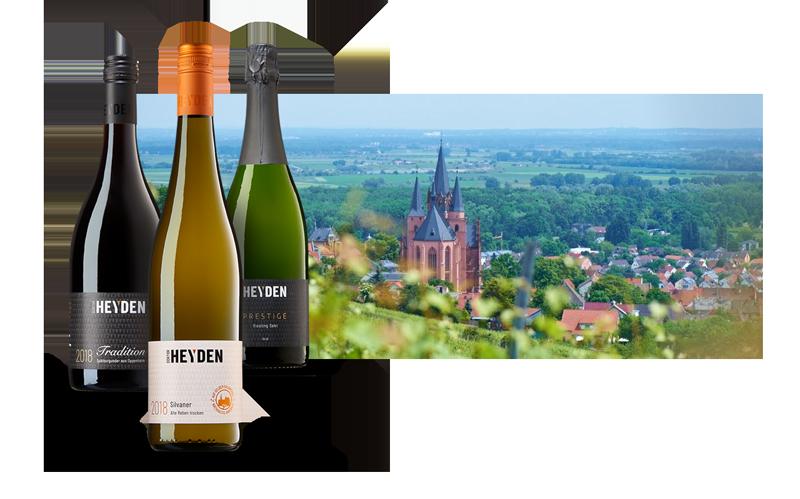 3 Flaschen Wein von Dr. Heyden und Aussicht auf Weinberge